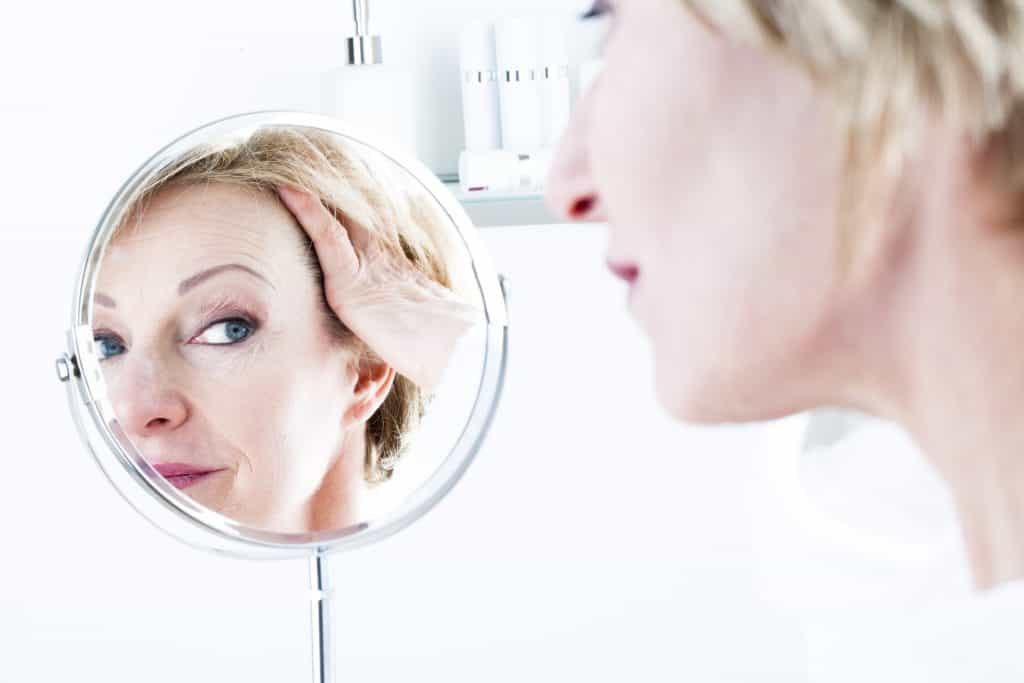 Woman In The Mirror, facial veins, older woman, wrinkles,