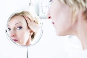 Woman In The Mirror, facial veins, older woman, wrinkles,