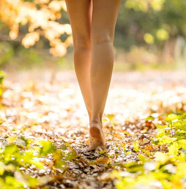 Walking outside, woods, happy, after varicose, vein treatment