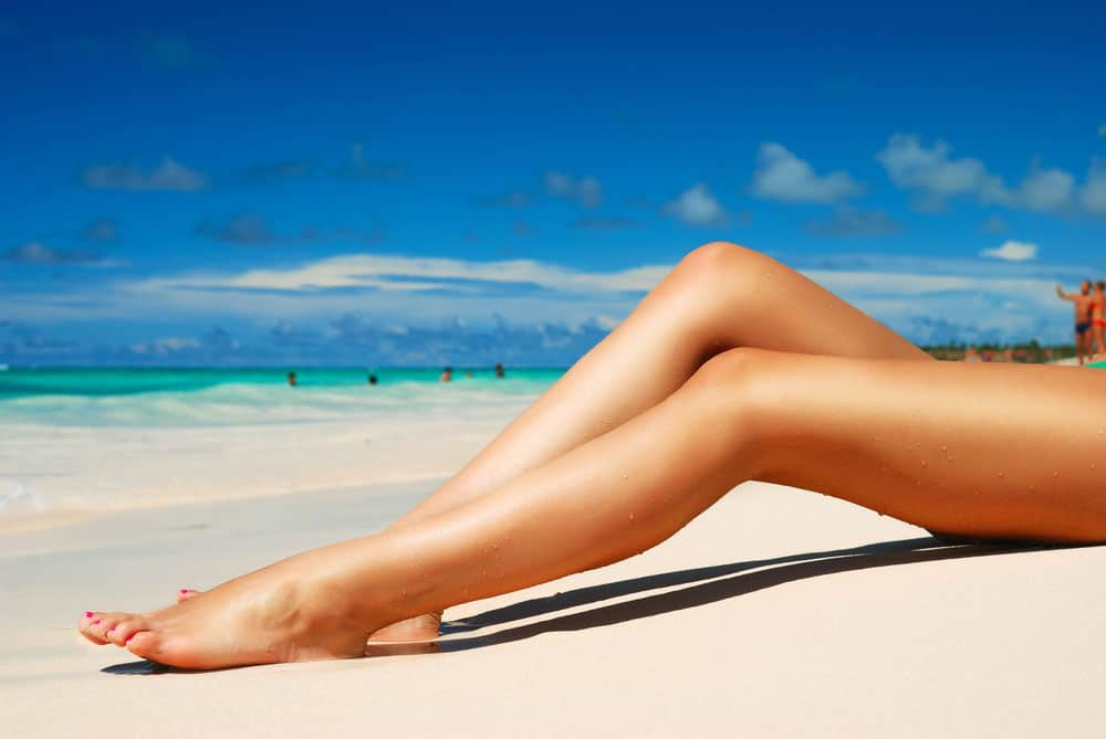 Legs, beach, sun, no more painful varicose vein issues